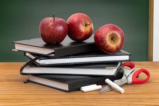 Apple, books, chalk, blackboard